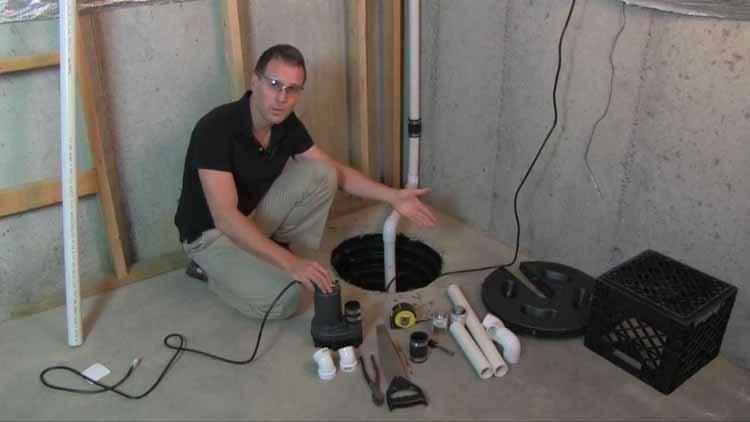 A Man Installing The Wayne ESP25 battery backup sump pump